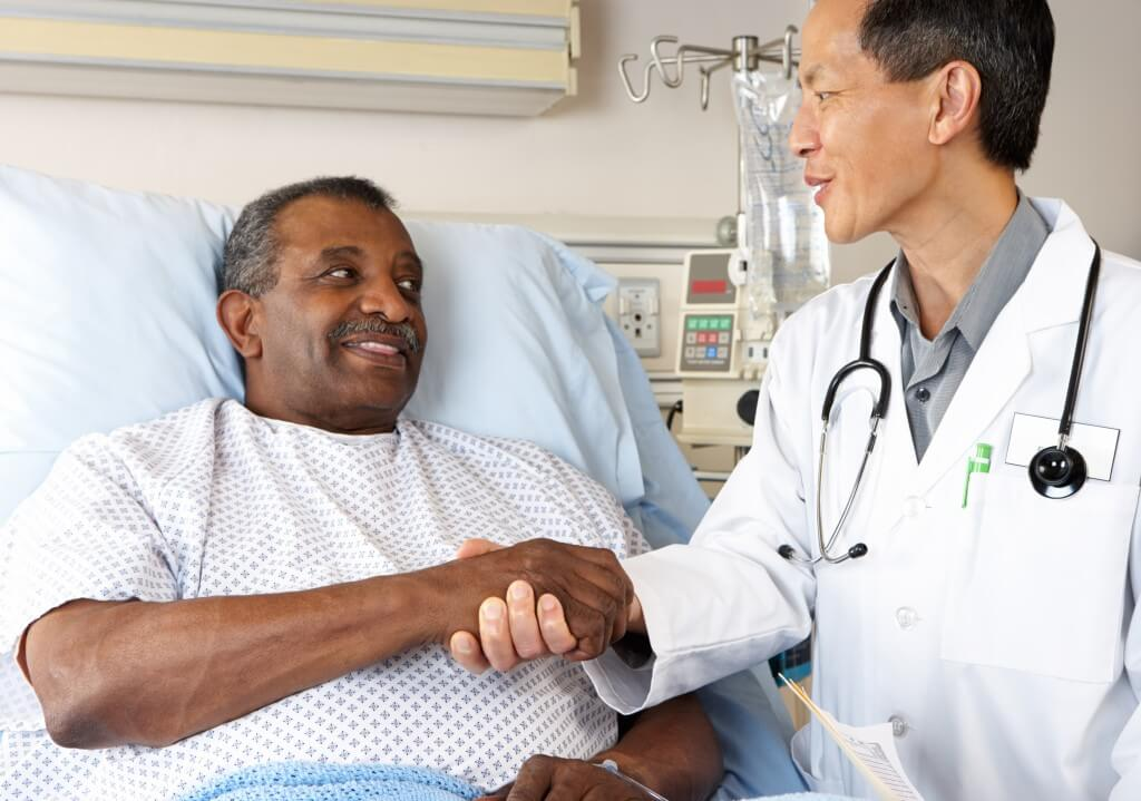 Doctor Visiting Senior Male Patient