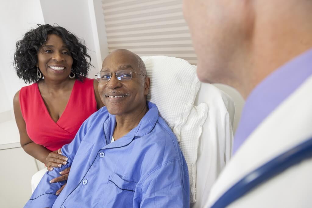 Senior Man Patient in Hospital Bed